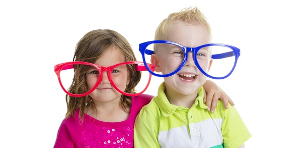 Young boy and young girl pictured together wearing novelty glasses